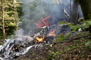 Debris of two sport planes is seen near the village of Cerveny Kamen